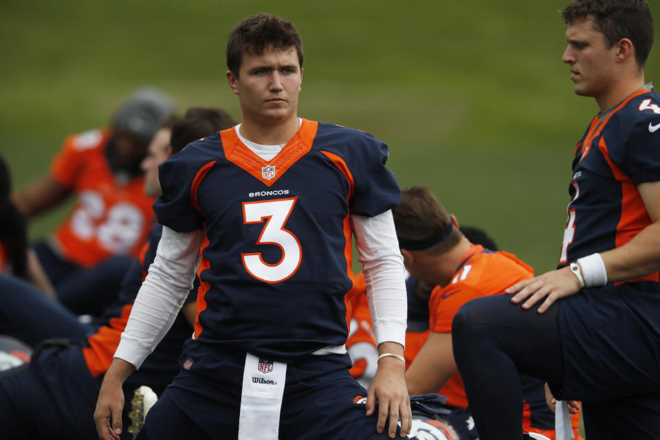 Denver Broncos rookie quarterback Drew Lock is currently holding out of training camp. (AP)