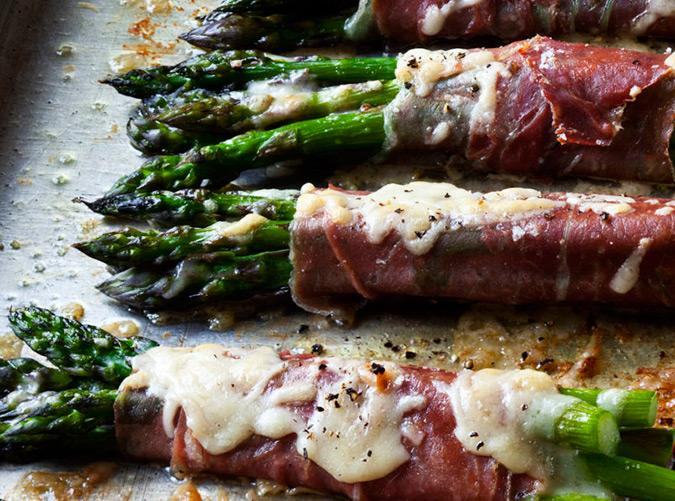 "<h2>3. Asparagus and Prosciutto Bundles</h2> <p>The key to delicious veggies: Wrap them in cured charcuterie.</p> <p><a class=""cta-button-link"" href=""https://barefootcontessa.com/recipes/asparagus-prosciutto-bundles"" target=""_blank"">Get the recipe</a></p>"