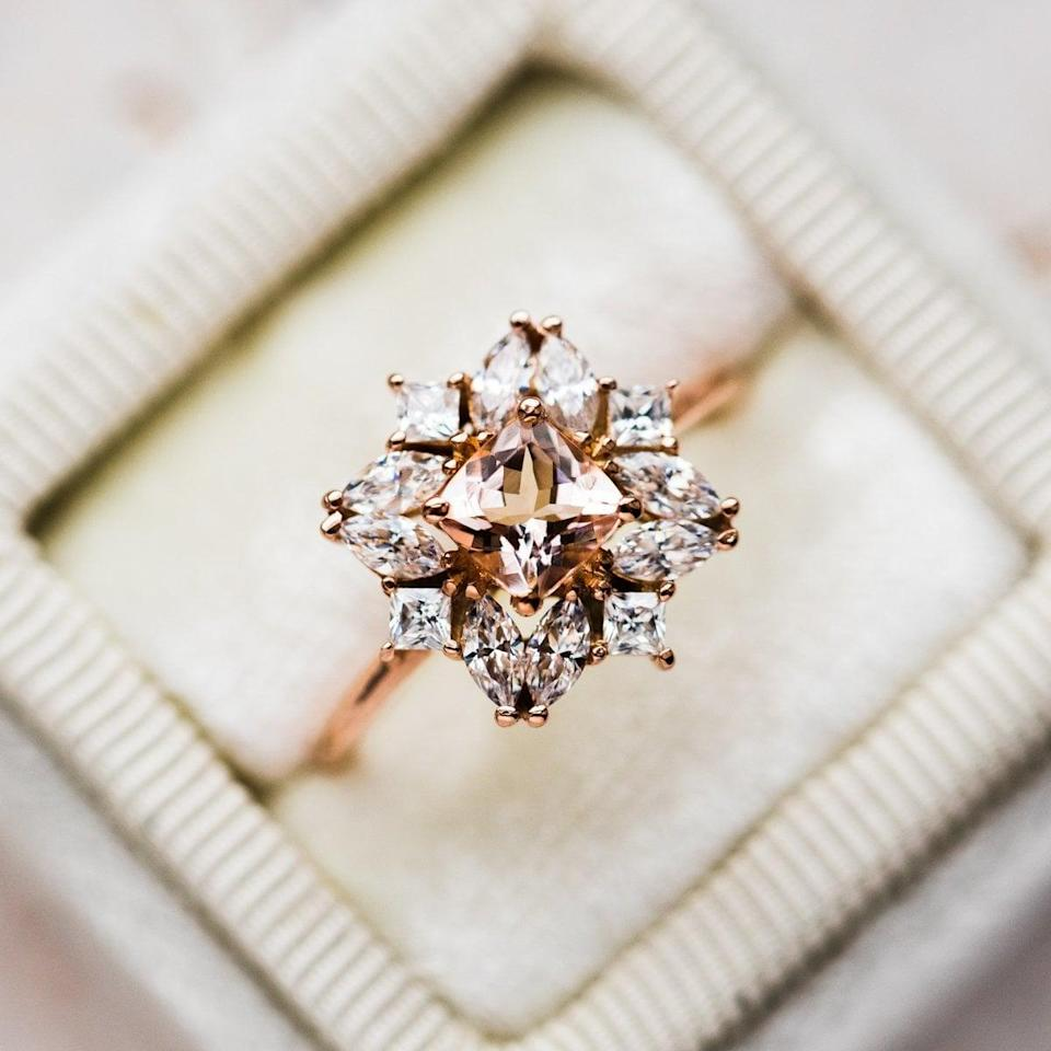 """<p>It's hard to top the gorgeous design of this <a href=""""https://www.popsugar.com/buy/Jasmine-Morganite-Cluster-Ring-531209?p_name=Jasmine%20Morganite%20Cluster%20Ring&retailer=localeclectic.com&pid=531209&price=290&evar1=fab%3Aus&evar9=44555978&evar98=https%3A%2F%2Fwww.popsugar.com%2Fphoto-gallery%2F44555978%2Fimage%2F47011758%2FJasmine-Morganite-Cluster-Ring&list1=wedding%2Cjewelry%2Crose%20gold%2Cengagement%20rings&prop13=api&pdata=1"""" rel=""""nofollow noopener"""" class=""""link rapid-noclick-resp"""" target=""""_blank"""" data-ylk=""""slk:Jasmine Morganite Cluster Ring"""">Jasmine Morganite Cluster Ring</a> ($290). The ring is inspired by a jasmine flower, after all.</p>"""