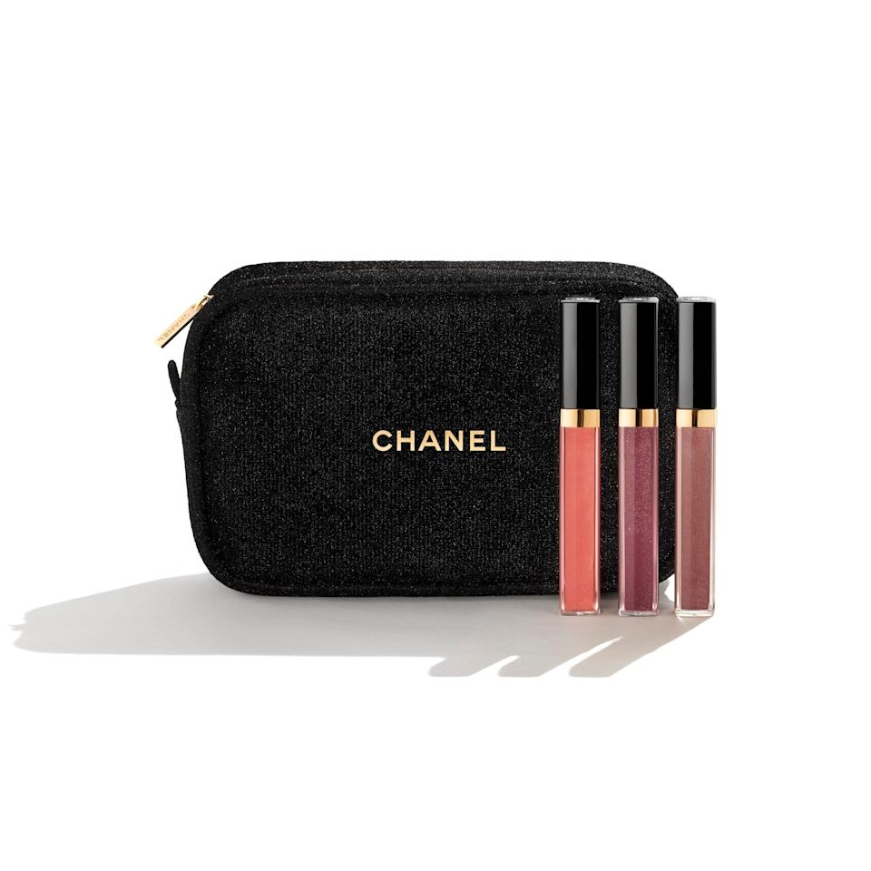 """For that special someone, this splurgy set from Chanel has threeshimmering lipgloss shades to try. And yes, this pouch is a part of the package as well.<a href=""""https://fave.co/34xdR9H"""" target=""""_blank"""" rel=""""noopener noreferrer"""">Find it for $92 at Chanel</a>."""