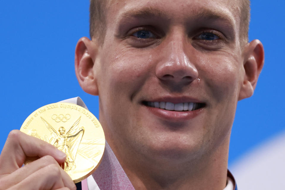 <p>TOPSHOT - Gold medallist USA's Caeleb Dressel poses with their medal after the final of the men's 100m freestyle swimming event during the Tokyo 2020 Olympic Games at the Tokyo Aquatics Centre in Tokyo on July 29, 2021. (Photo by Odd ANDERSEN / AFP) (Photo by ODD ANDERSEN/AFP via Getty Images)</p>