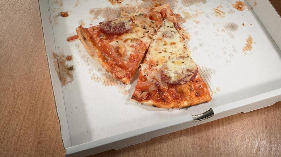 Greasy pizza boxes can be recycled but need to be cleared of all food scraps. Source: Getty