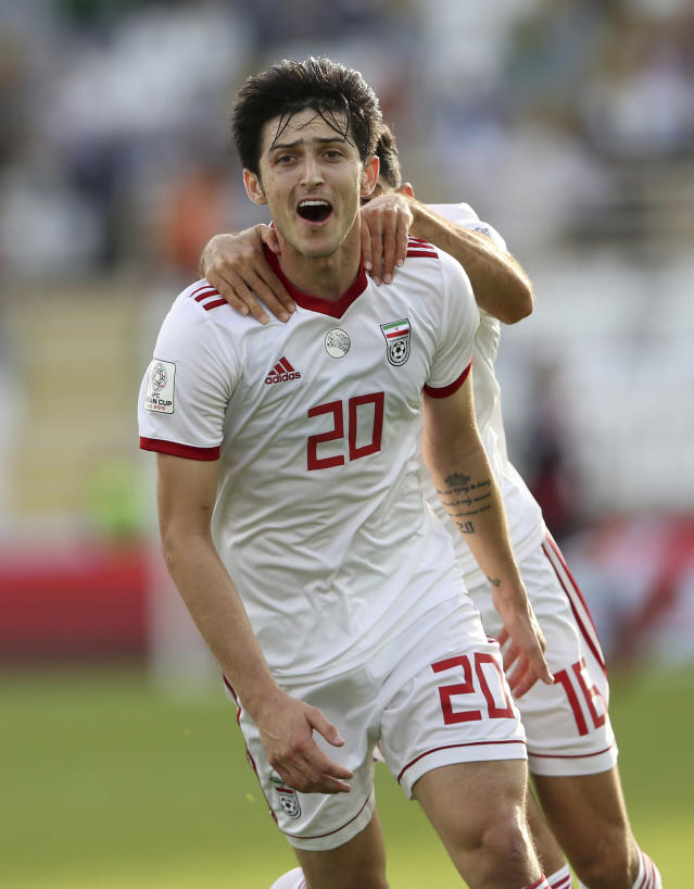 Iran's forward Sardar Azmoun celebrates after scoring his side's second goal during the AFC Asian Cup group D soccer match between Iran and Vietnam at Al Nahyan Stadium in Abu Dhabi, United Arab Emirates, Saturday, Jan. 12, 2019. (AP Photo/Kamran Jebreili)