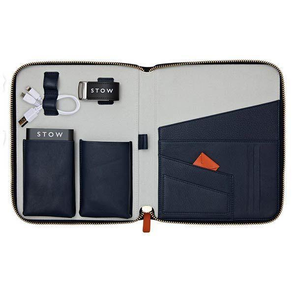 """<p>Stow's leather case is armed with a plethora of functional tech accessories – use it to organise documents, credit cards, loyalty cards, photo IDs and even a mobile phone. Other great features come in the form of two hand-stitched leather pockets, perfect for storing passports and boarding-passes, and there's even a portable power bank with cable and 32GB USB memory stick.</p><p>£395, <a href=""""https://www.fortnumandmason.com/stow-first-class-leather-tech-case-sapphire-blue-pale-grey"""" rel=""""nofollow noopener"""" target=""""_blank"""" data-ylk=""""slk:Stow London"""" class=""""link rapid-noclick-resp"""">Stow London</a>.</p>"""