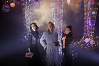 Models Angeliki Tsionou, Michaela Tomanova and Sheherazade Dakhlaoui, from left to right, display creations by Julien Fournie for his Haute Couture Spring/Summer 2021 fashion collection for a digital presentation of the fashion week, in Paris, Thursday, Jan. 7, 2021. With shows taking place behind closed doors due to the virus pandemic, some designers such as Julien Fournie are becoming versatile: Getting their designs out to the public by making a film of their collection and streaming it online. (AP Photo/Francois Mori)