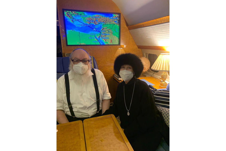 Jonathan Pollard, left, and his wife Esther sit inside a private plane provided by American casino magnate Sheldon Adelson, on route to land in Ben Gurion International airport near Tel Aviv, Israel, Wednesday, Dec. 30, 2020. Pollard, who spent 30 years in U.S. prison for spying for Israel, arrived in Israel early Wednesday with his wife, triumphantly kissing the ground as he disembarked from the aircraft in the culmination of a decades-long affair that had long strained relations between the two close allies. (AP Photo/Israel Hayom)