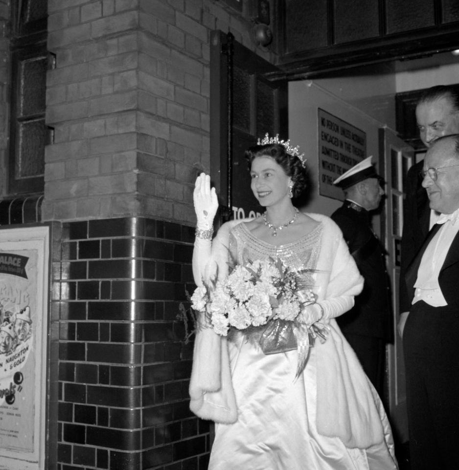 <p>A smiling Queen Elizabeth II waves to the crowds as she leaves the Royal Variety Show at Victoria Palace in 1960. (PA Archive) </p>