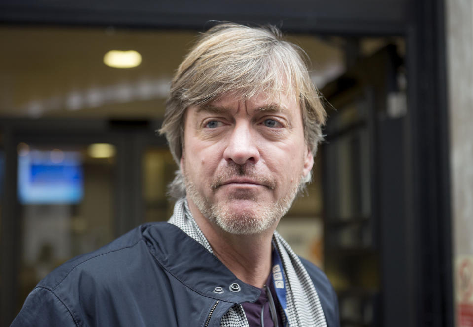 Richard Madeley speaks to the media outside BBC Broadcasting House in central London following the death of veteran broadcaster Sir Terry Wogan.