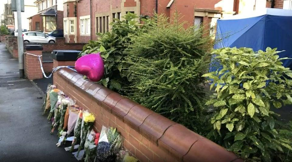 Tributes left at the scene in Burnley (PA) (PA Archive)