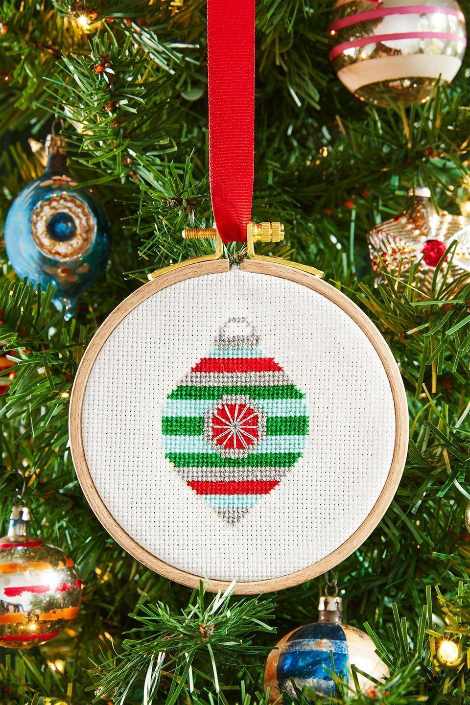 """<p>Crafter-noon? Yes, please! Even beginners can learn to cross-stitch quickly—and with our <a href=""""https://www.countryliving.com/diy-crafts/a6380/cross-stitch/"""" rel=""""nofollow noopener"""" target=""""_blank"""" data-ylk=""""slk:easy tutorials"""" class=""""link rapid-noclick-resp"""">easy tutorials</a>, you can guide the way. Of course, you don't just have to stick to cross-stitch designs. There are so many DIY ornament possibilities out there!</p><p><a class=""""link rapid-noclick-resp"""" href=""""https://www.amazon.com/LaRibbons-inch-Double-Satin-Ribbon/dp/B01HXCF7JQ?tag=syn-yahoo-20&ascsubtag=%5Bartid%7C10050.g.2218%5Bsrc%7Cyahoo-us"""" rel=""""nofollow noopener"""" target=""""_blank"""" data-ylk=""""slk:SHOP RIBBON"""">SHOP RIBBON</a></p>"""