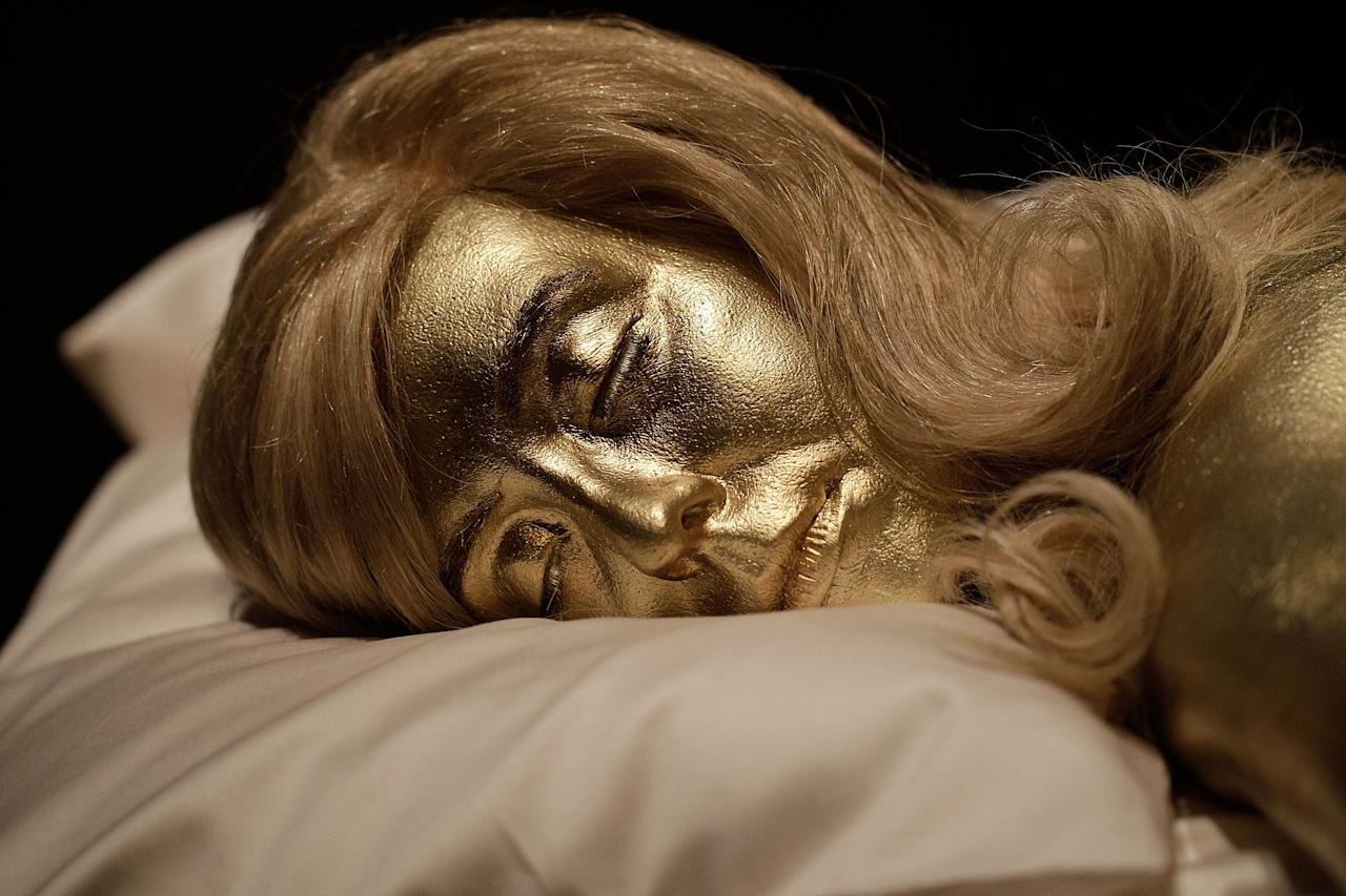 A recreation of the actress Jill Masterson covered in gold paint, a famous scene from the film Goldfinger, on display at the Fifty Years of Bond Style press view on July 5, 2012 in London, England. The Barbican is celebrating the 50th anniversary of James Bond with an exhibition showcasing the inside story of the design and style of the iconic films.  (Photo by Matthew Lloyd/Getty Images)