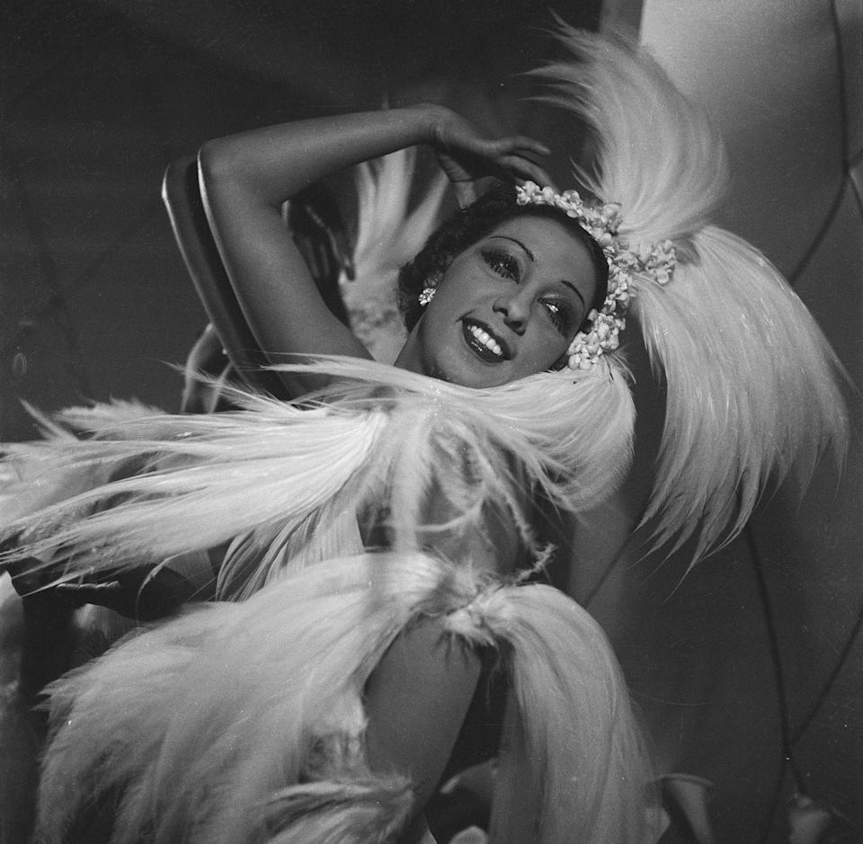 """<p>After Baker performed the <em>Danse Sauvage</em> with her partner, Joe Alex, in a feathered skirt (<a href=""""https://www.biography.com/performer/josephine-baker"""" rel=""""nofollow noopener"""" target=""""_blank"""" data-ylk=""""slk:and nothing else"""" class=""""link rapid-noclick-resp"""">and nothing else</a>), she became known for her elicit outfits. She often posed nude, or near nude, which was well-received by the French.</p>"""
