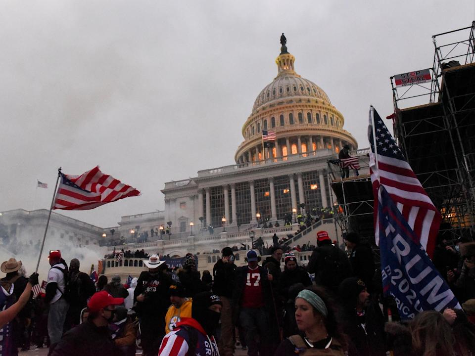 Police attempt to clear the US Capitol Building with tear gas as supporters of US President Donald Trump gather outside, in Washington, 6 January 2021 (REUTERS)