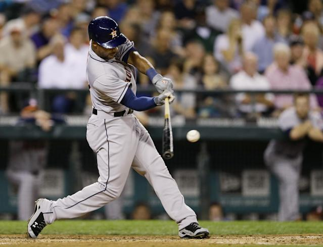 Houston Astros' L.J. Hoes hits a two-run double in the third inning of a baseball game against the Seattle Mariners, Tuesday, Sept. 10, 2013 in Seattle. (AP Photo/Ted S. Warren)