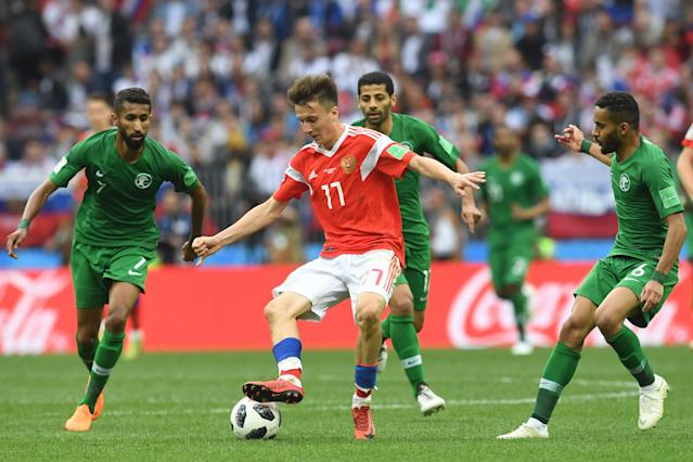 Russia's midfielder Aleksandr Golovin (C) vies with (fromL) Saudi Arabia's midfielder Salman Al-Faraj, Saudi Arabia's midfielder Taisir Al-Jassim and Saudi Arabia's defender Mohammed Al-Breik during the Russia 2018 World Cup Group A football match between Russia and Saudi Arabia at the Luzhniki Stadium in Moscow on June 14, 2018. (Getty Images)