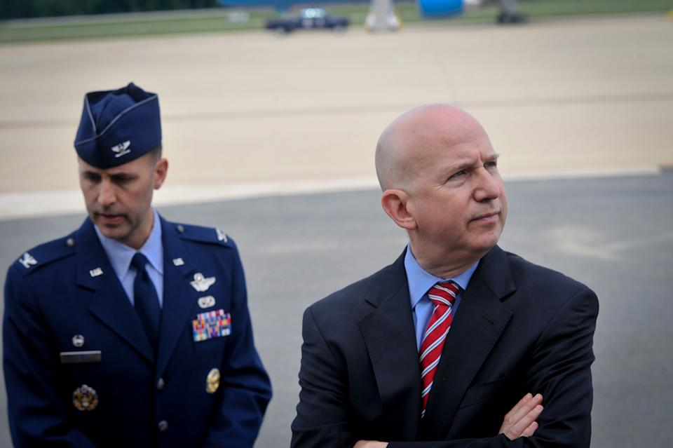 Delaware Gov. Jack Markell, right, and Col. Don Bevis, left, await the arrival of President Barack Obama on Air Force One at New Castle Air National Guard Base in New Castle, Del., Saturday, June 6, 2015, before attending a funeral for Beau Biden. Biden, the eldest son of Vice President Joe Biden, died of brain cancer May 30 at age 46. (AP Photo/Emily Varisco)