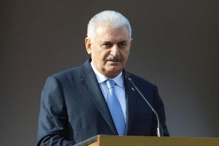 Turkish Prime Minister Binali Yildirim speaks to the media during a visit in Nicosia, northern Cyprus