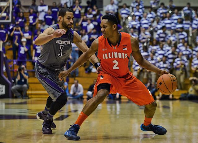Northwestern's Drew Crawford (1) guards Illinois' Joseph Bertrand (2) during the first half of an NCAA college basketball game in Evanston, Ill., on Sunday, Jan. 12, 2014. (AP Photo/Matt Marton)