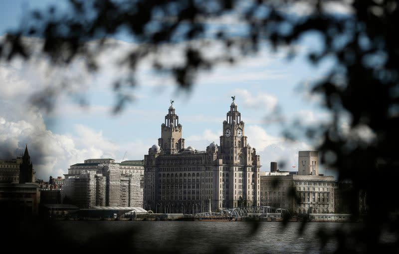 Liverpool's iconic waterfront property the Royal Liver building is viewed across the River Mersey in Birkenhead , northern England