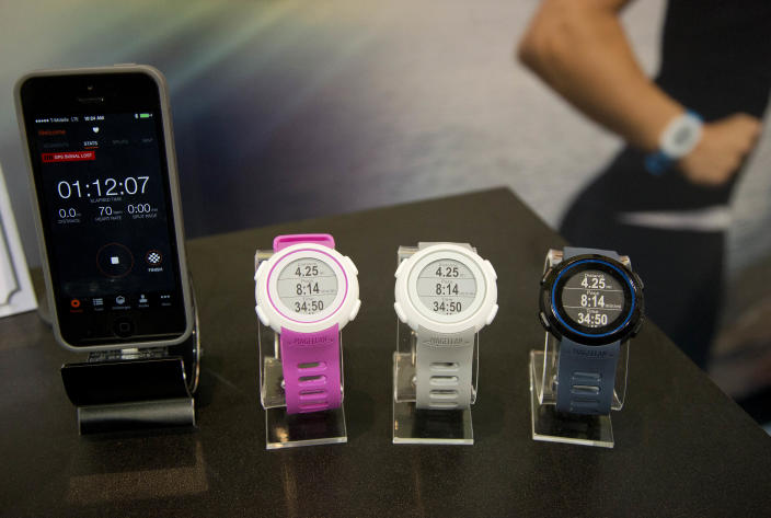 Magellan Echo smart sports watches sit on display at the International Consumer Electronics Show, Wednesday, Jan. 8, 2014, in Las Vegas. The watch can sync with mobile devices to make the most out of the user's sports apps. (AP Photo/Julie Jacobson)
