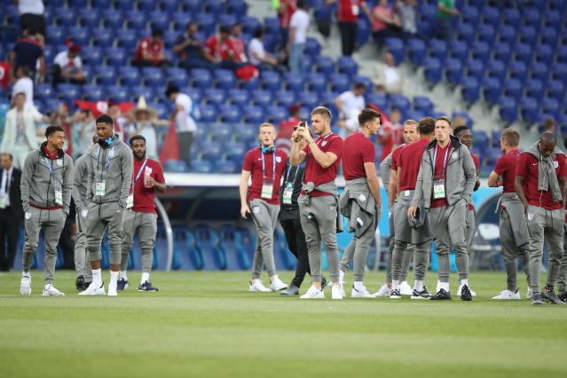 Flying away: England's players walk on the pitch prior to the start of the group G match with Tunisia