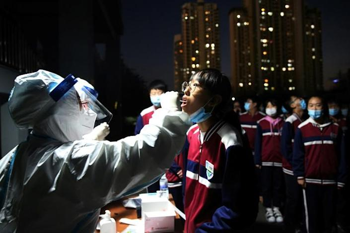 More than four million swabs have been collected in a matter of days in the Chinese port city of Qingdao as authorities test for the coronavirus
