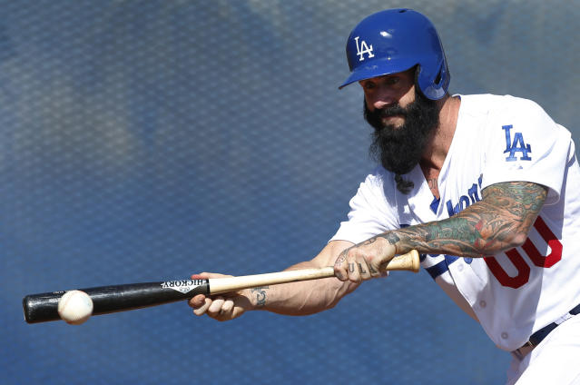 Los Angeles Dodgers pitcher Brian Wilson bunts during baseball spring training in Glendale, Ariz., Friday, Feb. 14, 2014. (AP Photo/Paul Sancya)