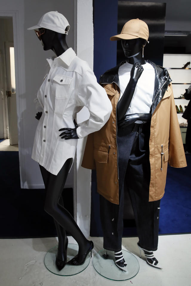 Designs are displayed as Rihanna unveils her first fashion designs for Fenty at a pop-up store in Paris, France, Wednesday, May 22, 2019. Singer Rihanna is the first black woman in history to head up a major Parisian luxury house, and the collection, named after the singer turned designer's last name, comprises of ready-to-wear, footwear, accessories, and eyewear and is available for sale Paris' Le Marais area from Friday and will debut online May 29. (AP Photo/Francois Mori)