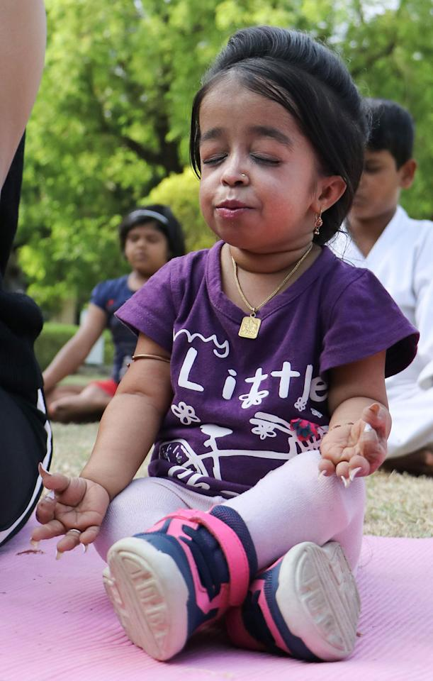 World's shortest woman Jyoti Amge performs Yoga ahead of the 5th International Day of Yoga 2019, in Nagpur. (Image: PTI)