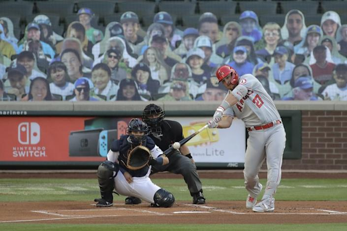 Angels' Mike Trout hits a solo home run during the first inning of a game against Seattle on Aug. 4