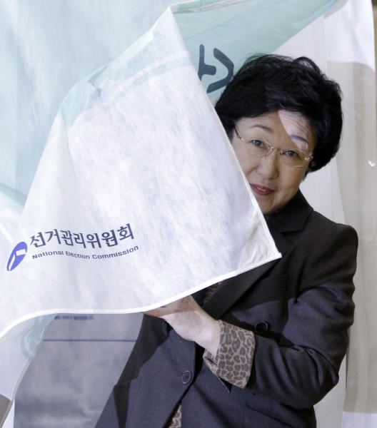 Han Myeong-sook, chairwoman of main opposition Democratic United Party comes out after casting her vote for the parliamentary election at a polling station in Seoul, South Korea, Wednesday, April 11, 2012. (AP Photo/Lee Jin-man)