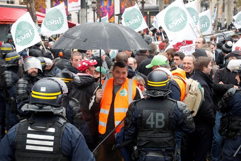 French farmers block the Champs Elysees avenue during a day of protest in Paris
