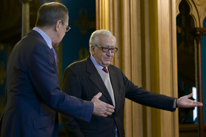 Russian Foreign Minister Sergey Lavrov, left, welcomes U.N. envoy for Syria Lakhdar Brahimi during their meeting in Moscow, Russia, on Saturday, Dec. 29, 2012. (AP Photo/Ivan Sekretarev)