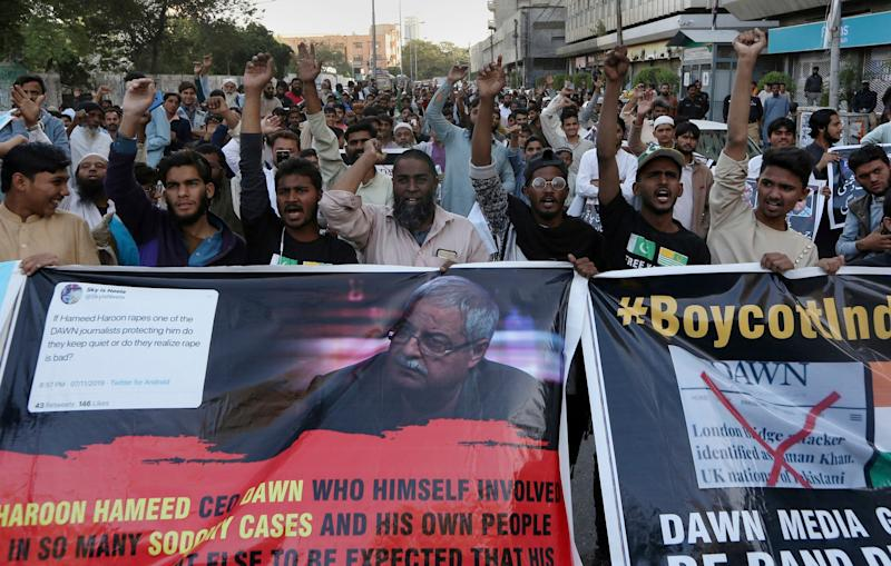 Angry Islamists chant slogans during a demonstration against the Pakistani newspaper Dawn, outside the Press Club in Karachi on Tuesday: AP