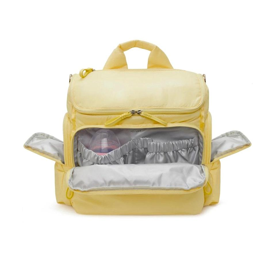 """As a new mom, I can't live without this baby bag. Every person who's come across it—parent or not—has complimented it because it's not only objectively cute; it's also unbelievably functional. There are tons of zippered pockets (plenty of them insulated for milk), a removable changing caddy to easily whip out the essentials, convertible backpack straps, stroller clips, and so much more. It keeps everything so organized and easily accessible, and the cherry on top is that <a href=""""https://cna.st/affiliate-link/TmDrEmPPxxd5sQWzuiJJXeiQK1fxz1RSsNyr327XmkeV8CgCi9ijAazrCmwtU4zW3Rfev2J38KLu8VQpKjGWCDbT3QFAyy4Xybddm69GTmLPGp5pvFVzki2jWHvZWP5PcVGLsqZ?cid=61019a4475746db6a358b3b6"""" rel=""""nofollow noopener"""" target=""""_blank"""" data-ylk=""""slk:the black version"""" class=""""link rapid-noclick-resp"""">the black version</a> can go in the washing machine. —<em>Shanna Shipin, commerce managing editor and mom of one</em> $275, Caraa. <a href=""""https://caraasport.com/products/baby-bag-medium?variant=32820843970640"""" rel=""""nofollow noopener"""" target=""""_blank"""" data-ylk=""""slk:Get it now!"""" class=""""link rapid-noclick-resp"""">Get it now!</a>"""