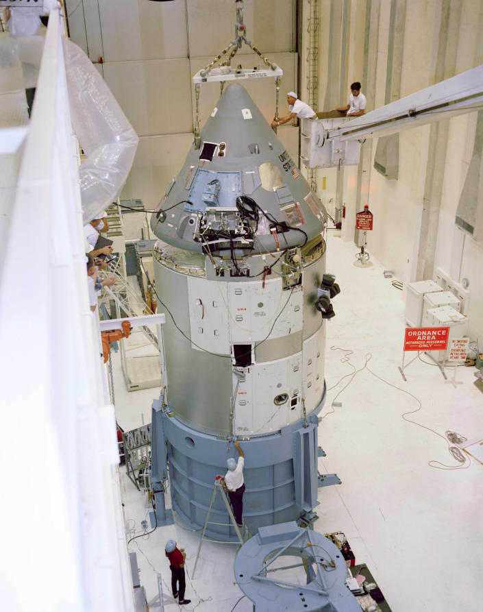 In this 1967 photo made available by NASA, the Apollo Command/Service Module in the Manned Spacecraft Operations Building at the Kennedy Space Center in Florida is prepared for the Apollo/Saturn 204 mission. During a launch pad test on Jan. 27, 1967, a flash fire erupted inside the capsule killing Apollo crew members Roger Chaffee, Edward White II, and Virgil Grissom. (NASA via AP)