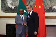 Chinese Foreign Minister Wang Yi shakes hands with Maldivian Foreign Minister Abdulla Shahid in Beijing in September 2019 as Beijing pursues ties in the archipelago