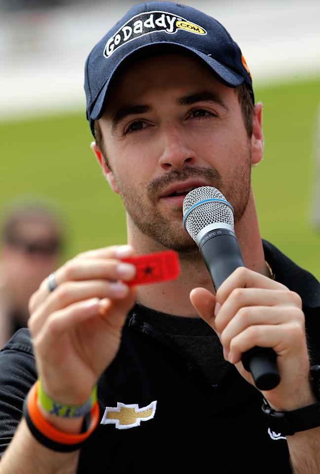 FORT WORTH, TX - MAY 21:  IZOD IndyCar Series driver James Hinchcliffe reads the name printed on a raffle ticket during a drawing for a 2012 Chevrolet Camaro on May 21, 2012 at Texas Motor Speedway in Fort Worth, Texas. The Camaro was awarded to a Northwest ISD student for their outstanding academic efforts and attendance throughout the school year.  (Photo by Tom Pennington/Getty Images for Texas Motor Speedway)