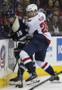 Columbus Blue Jackets' Boone Jenner, left, and Washington Capitals' Lars Eller, of Denmark, right, fight for a loose puck during the first period of an NHL hockey game Tuesday, Feb. 12, 2019, in Columbus, Ohio. (AP Photo/Jay LaPrete)