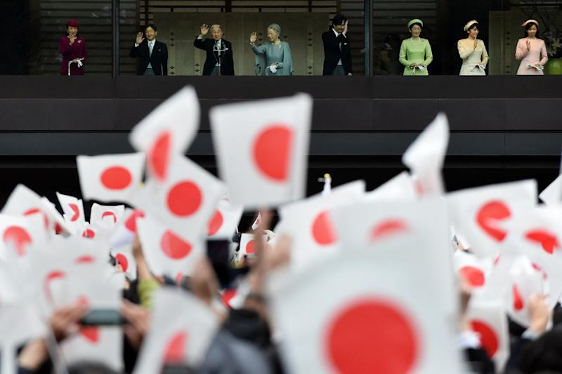 The Imperial Palace said some 23,000 people attended Emperor Akihito's birthday address on December 23, 2015, waving small Japanese flags as crowds shouted 'Banzai' or 'Long live' (AFP Photo/Toshifumi Kitamura)