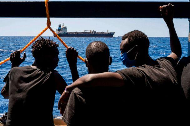 PHOTO: Migrants onboard the Sea-Watch 4 civil sea rescue ship watch towards the oil tanker Maersk Etienne off the coast of Malta on Aug. 27, 2020. (Thomas Lohnes/AFP via Getty Images)