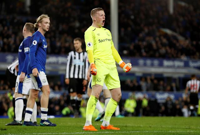 "Soccer Football - Premier League - Everton v Newcastle United - Goodison Park, Liverpool, Britain - April 23, 2018 Everton's Jordan Pickford celebrates after the match Action Images via Reuters/Lee Smith EDITORIAL USE ONLY. No use with unauthorized audio, video, data, fixture lists, club/league logos or ""live"" services. Online in-match use limited to 75 images, no video emulation. No use in betting, games or single club/league/player publications. Please contact your account representative for further details."