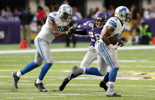 <p>Detroit Lions running back Theo Riddick (25) gets a block from teammate Eric Ebron (85) as he runs from Minnesota Vikings free safety Harrison Smith (22) during the first half of an NFL football game Sunday, Nov. 6, 2016, in Minneapolis. (AP Photo/Jim Mone) </p>