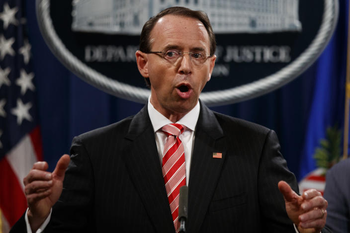 Deputy Attorney General Rod Rosenstein holds a news conference at the Department of Justice on Friday. (Photo: Evan Vucci/AP)