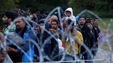 FILE PHOTO: Migrants make their way after crossing the border at Zakany, Hungary October 16, 2015.