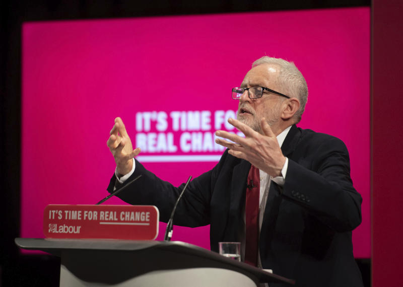 Britain's main opposition Labour Party leader Jeremy Corbyn speaks at the launch of the Labour Party race and faith manifesto, in London, Tuesday Nov. 26, 2019.  The race and faith manifesto comes after the Labour Party and its leader Jeremy Corbyn have been deeply tarnished by anti-Semitism accusations, as the UK prepares to go to the polls in a General Election on Dec. 12. (Joe Giddens/PA via AP)