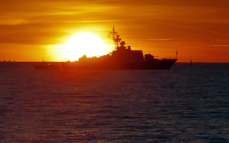 A Russian Coast Guard ship patrols the Gulf of Finland waters outside a G-20 summit at a sunset in St. Petersburg, Russia on Wednesday, Sept. 4, 2013. U.S. President Barack Obama will seek to bolster international support for a strike against Syria during talks with world leaders this week at the Group of 20 summit. Those efforts will pit him against Russian president and summit host Vladimir Putin, who has perhaps done the most to stymie international efforts to oust Syria's Bashar Assad. The G-20 summit begins on Thursday, Sept. 5. (AP Photo/Dmitry Lovetsky)