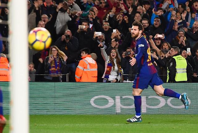 Barcelona forward Lionel Messi celebrates a goal during the Spanish league football match between FC Barcelona and Deportivo Alaves at the Camp Nou stadium in Barcelona on January 28, 2018 (AFP Photo/Josep LAGO)