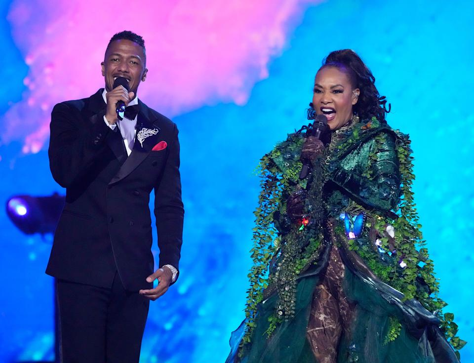 """L-R: Host Nick Cannon and Vivica A. Fox, who turned out to be Mother Nature, in the """"Back To School"""" episode of """"The Masked Singer."""""""