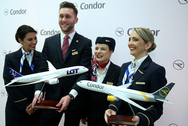 Flight attendants pose before a news conference of Ralf Teckentrup, chief of Condor airlines, and Rafal Milczarski, CEO of LOT Polish Airlines, in Frankfurt, Germany, January 24, 2020. REUTERS/Ralph Orlowski